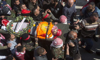 Aerial view of man carried on stretcher in large crowd