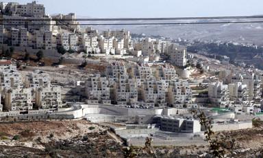 Numerous apartment buildings cover a hillside