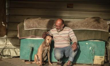A man pets a dog