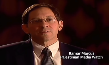Screenshot shows man in glasses and suit