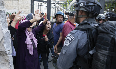 Women confront soldiers near gate