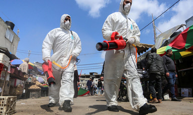 Medical workers disinfecting market