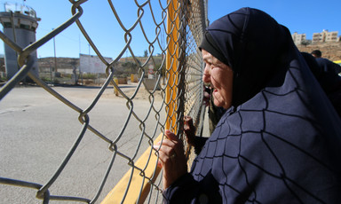 Woman holds barbed wire