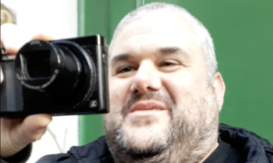 A man holds a camera