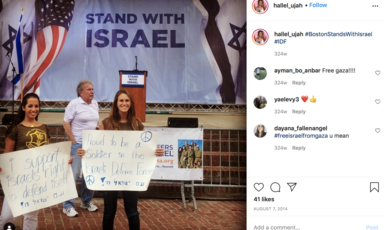 People hold signs with slogans supporting Israeli army