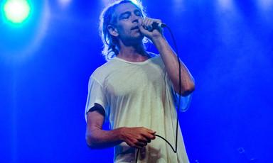 Singing man holding microphone