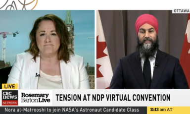 Two people speak side by side on a television screen