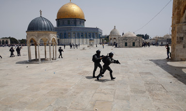 Armed soldiers with Dome of the Rock in background