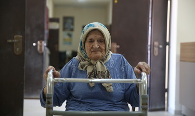 Woman holds a mobility aid