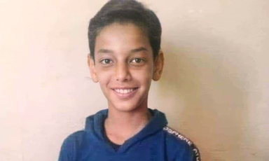 A young boy smiles