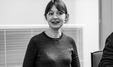 Woman in crewneck and bangs in black and white picture
